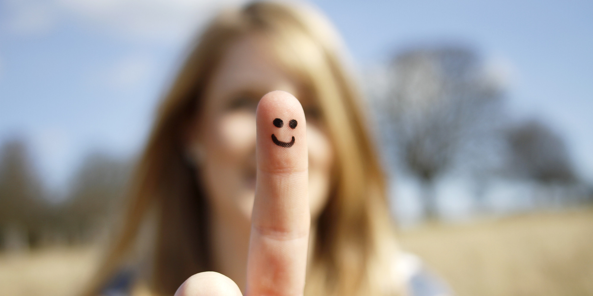 Happy face drawn onto a girl's finger